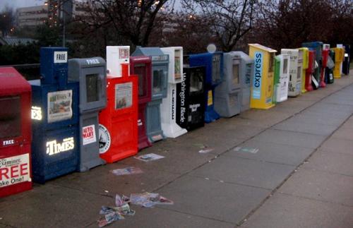 A soggy free newspaper bin line on a D.C. weekend.